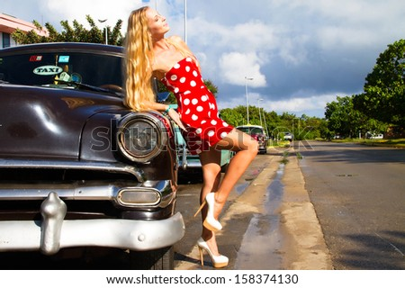 Old Chevrolet in front of colorful  - stock photo