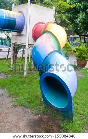 Old children playground in park - stock photo