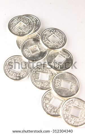 Old china coins, money, currency or finance. Isolated on white background. Concept of wealth, business, investment or banking. Symbol of rich, growth. - stock photo