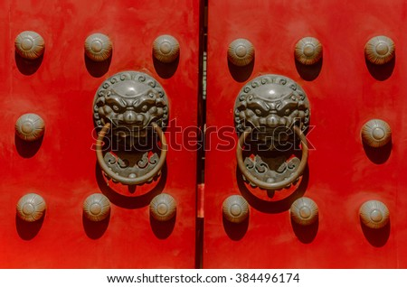 Old chinese door style with lion head knocker.
