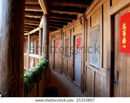 Old Chinese village wooden building-Fujian tulou house. - stock photo