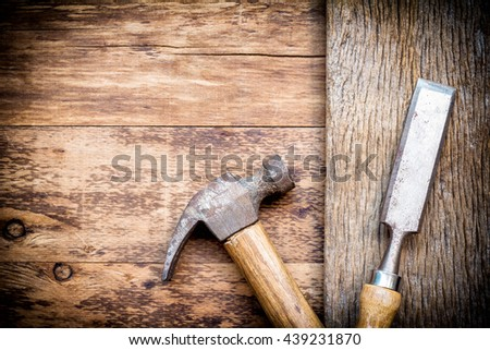 Old chisel and  hammer in a carpentry workshop