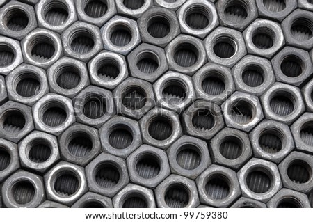 Old chrome nuts ordered structure - stock photo