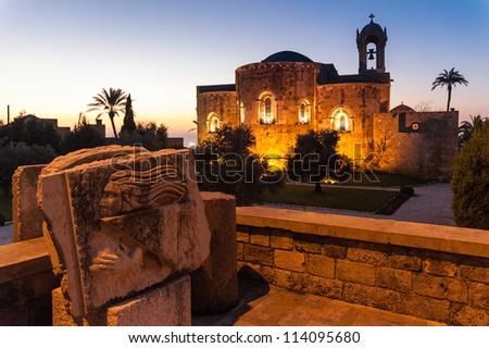 Old church and archaeological finds at sunset in Byblos, Lebanon
