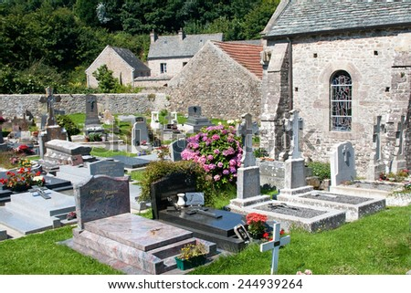 Old church and cemetery in Omonville-la-Petite, Normandy, France - stock photo