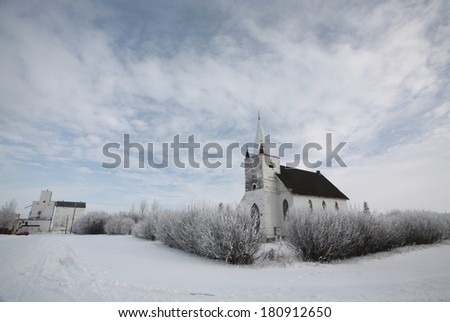 Old church and grain elevator in Aylesbury - stock photo