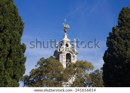 Old church bell tower with cock and cross   - stock photo