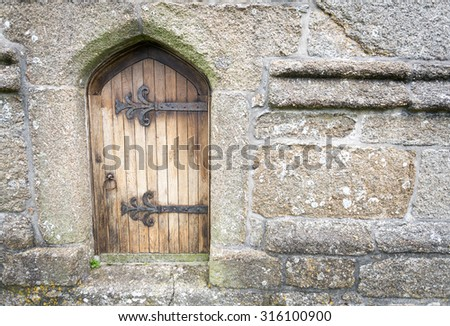 old church door with large hinges - stock photo