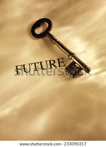 Old church key on a gold lit background with copy space and the word future