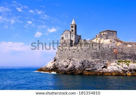 Old church on a rocky coastal outcrop at Portovenere, Italy - stock photo