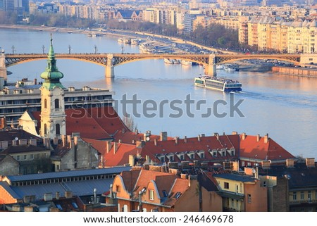 Old church tower and Margaret bridge across Danube river, Budapest, Hungary - stock photo
