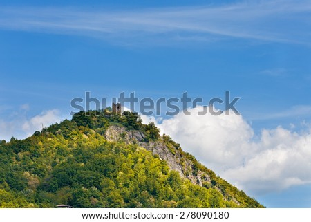 Old church tower on the hill - stock photo