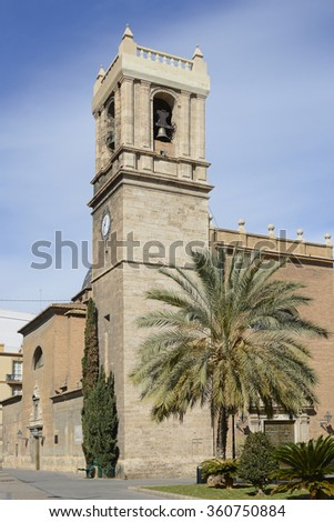 Old church with bell tower on main road leading to seafront and port in Valencia, Spain - stock photo