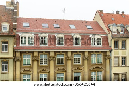 Old city building with a red tile roof city of Strasbourg in the autumn - stock photo