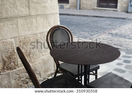 old city cafe terrace tables in Lviv - stock photo