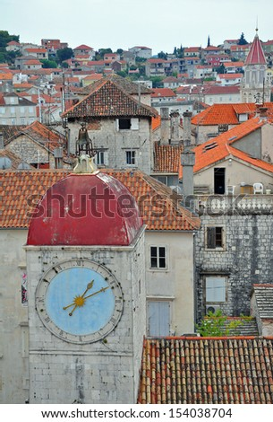 Old city clock tower in Trogir, Croatia, vertical shot - stock photo