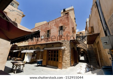 Old city downtown ancient streets perspective view in Saida, Lebanon - stock photo