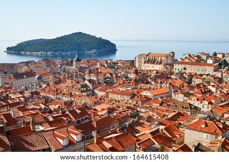 Old City of Dubrovnik on the backgrounds of sea with island, Croatia. - stock photo