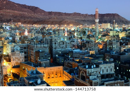 Old city of Sanaa the capital of Yemen. View on the city from roof at sunset time - stock photo