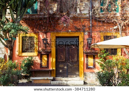 Old city street in Rome, Italy. On sunny autumn or spring day. - stock photo