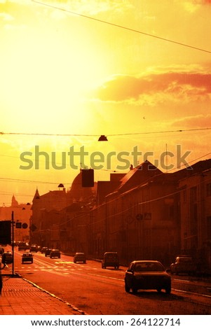 old city street with cars people - stock photo