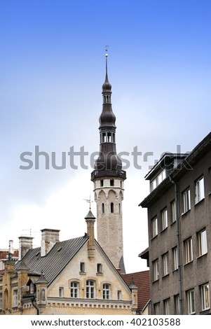 Old city, Tallinn, Estonia. A old houses and weather vane Old Thomas on the Town hall tower - stock photo