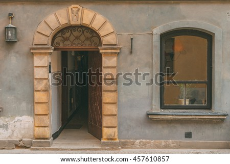 Old city vintage elements Rounded decorated door with rounded window on a grey wall Historical city elements Classic european architecture Postcard concept Travel inspiration Luxury estate background