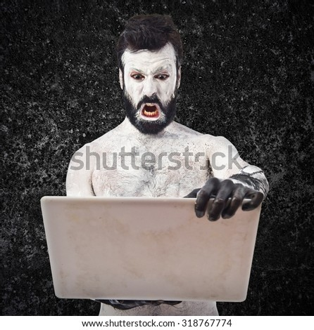 Old civilisation man with laptop - stock photo