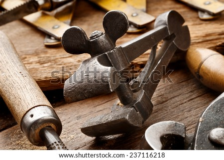 old clamp on aged carpenter workbench - stock photo