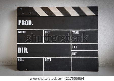 Old clapper board  on white background - stock photo