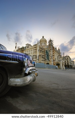 Old classic car parked in front of Revolution Palace building in Havana, cuba - stock photo