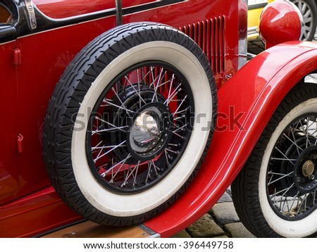 old classic car wheels and tires - stock photo