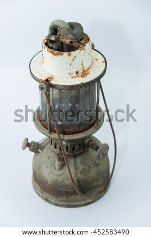 Old classic dusty oil lamp on white background. - stock photo