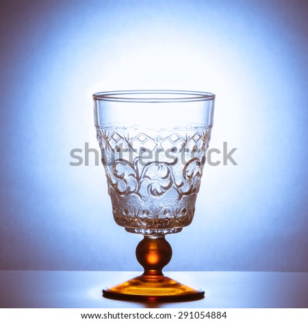 Old classic wine glass on the table - stock photo
