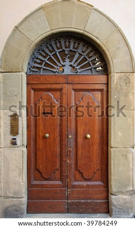 Old classical style door in Siena, Italy