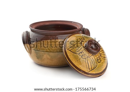 Old clay cooking pot, isolated on white - stock photo