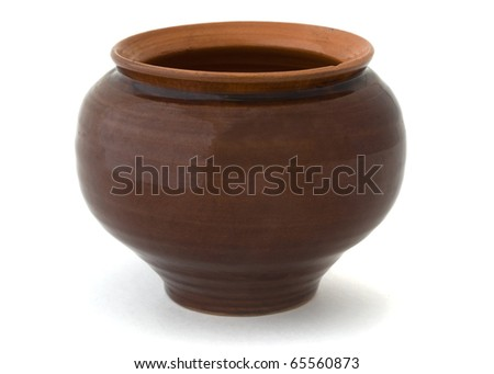 Old clay cooking pot isolated on white - stock photo