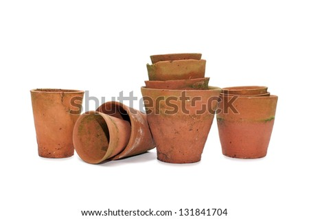 Old clay flower pots isolated on white background - stock photo