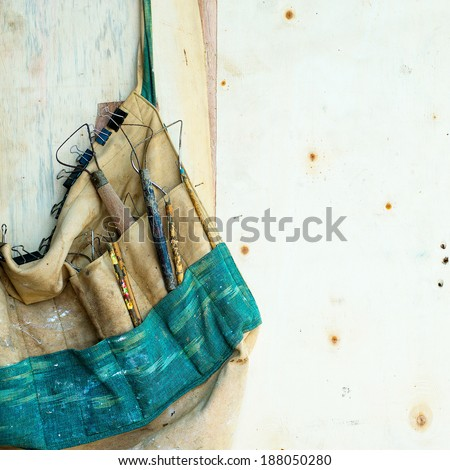 Old Clay painters tool bag Sculptor works with concentration in the studio on a fragment of plaster sculpture. - stock photo