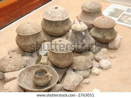 Old clay pots for cooking - stock photo