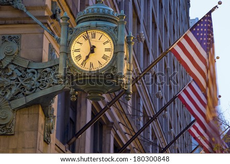 Old Clock and Flags - State Street. Seen early morning before sunrise. - stock photo