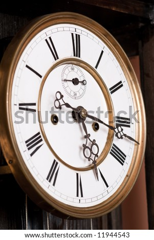 Old clock face with roman numerals.