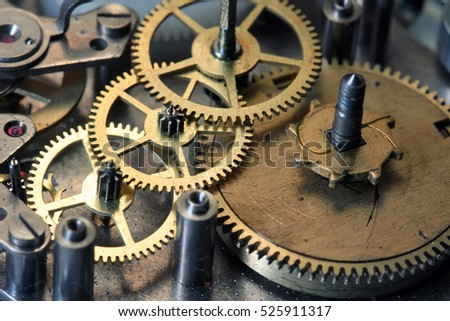 old clock mechanism with screws and gears disassembled