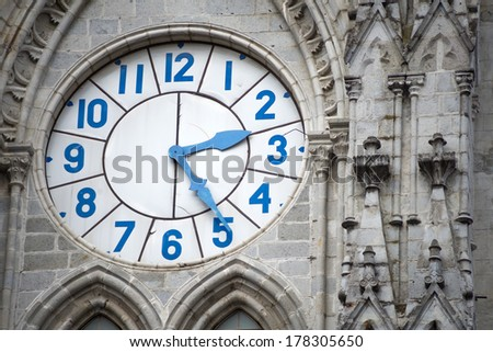 Old clock of the Basilica of Quito, Ecuador. - stock photo