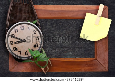 old clock vintage picture and blank note paper in wood background. View with copy space. selective focus. - stock photo