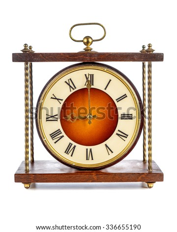 Old clock with roman numerals showing nine o'clock on white background - stock photo