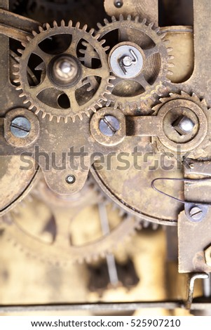 Old clockwork dirty with dust and lubricating oil. Selective focus. Shallow depth of field.