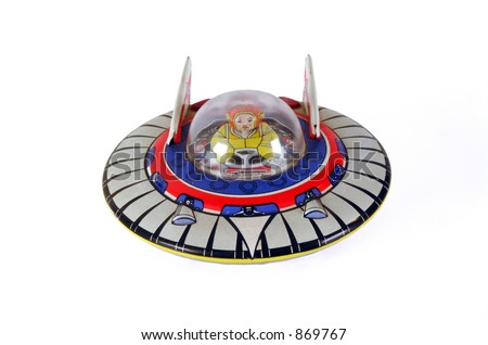 Old clockwork tin flying saucer toy with pilot.
