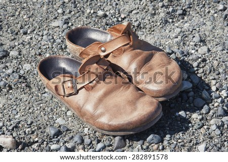 Old Clogs on the Rocks - Saanichton, Vancouver Island, British Columbia, Canada - stock photo