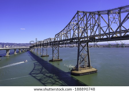 Old, closed for traffic span of San Francisco-Oakland Bay Bridge being dismantled after opening of a new bridge - stock photo